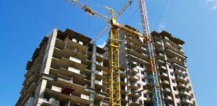 Skyscraper Construction. Two Cranes Near Building Under Construc